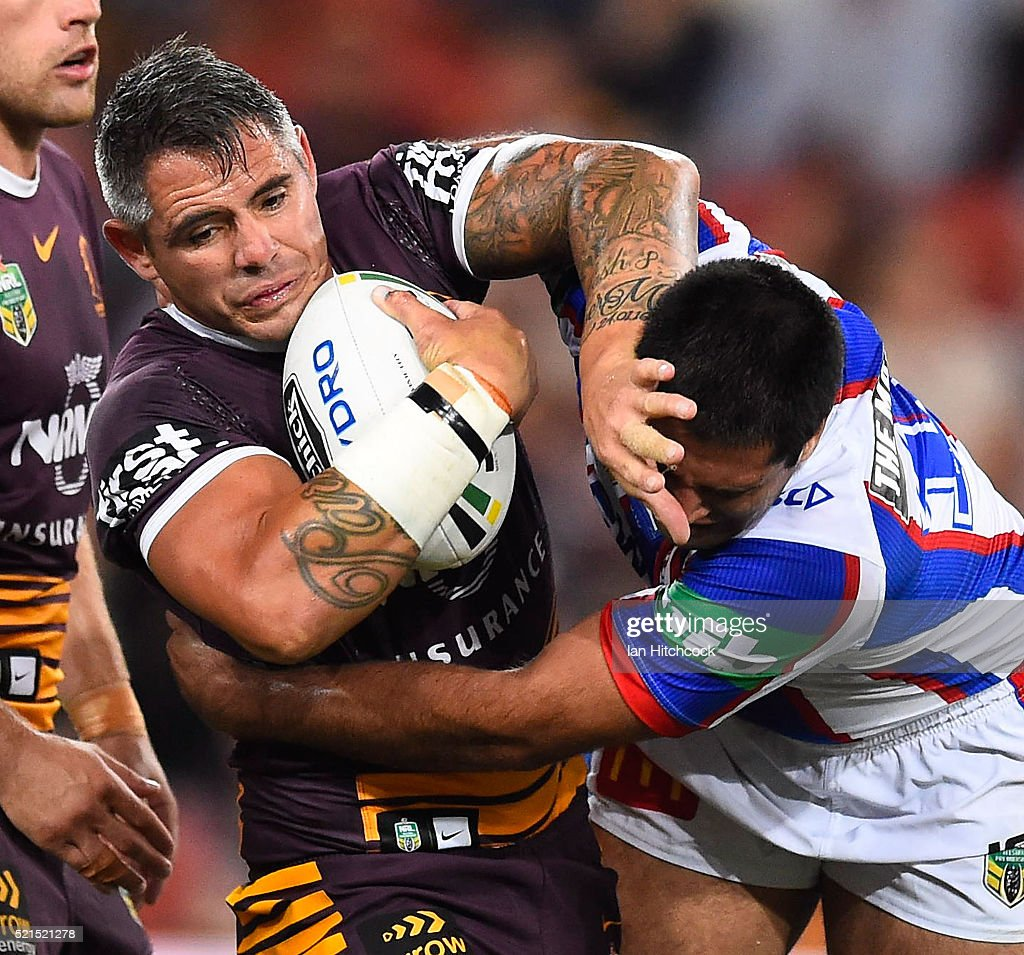 Corey Parker of the Broncos is tackled by Dave Bhana of the Knights during the round seven NRL match between the Brisbane Broncos and the Newcastle Knights at Suncorp Stadium on April 16, 2016 in Brisbane, Australia.
