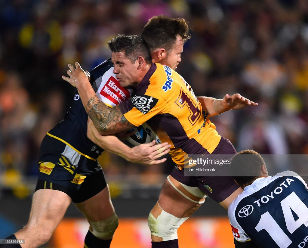 Corey Parker of the Broncos is tackled by Gavin Cooper of the Cowboys the NRL 1st Elimination Final match between the North Queensland Cowboys and the Brisbane Broncos at 1300SMILES Stadium on September 13, 2014 in Townsville, Australia.