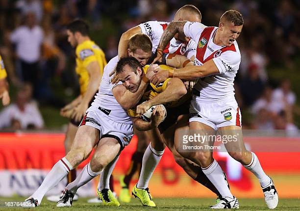 Corey Parker of the Broncos is tackled by the Dragons defence during the round two NRL match between the St George Dragons and the Brisbane Broncos...