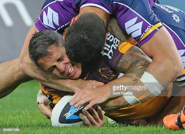 Corey Parker of the Broncos is tackled during the round 26 NRL match between the Melbourne Storm and the Brisbane Broncos at AAMI Park on September 5...