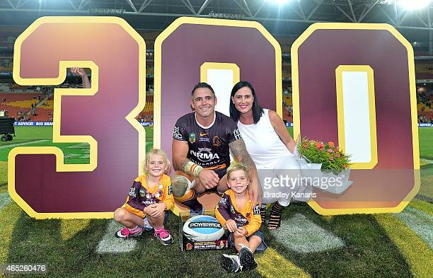 Corey Parker of the Broncos poses for a photo with his wife and two children to celebrate his 300th NRL match after the round one NRL match between...