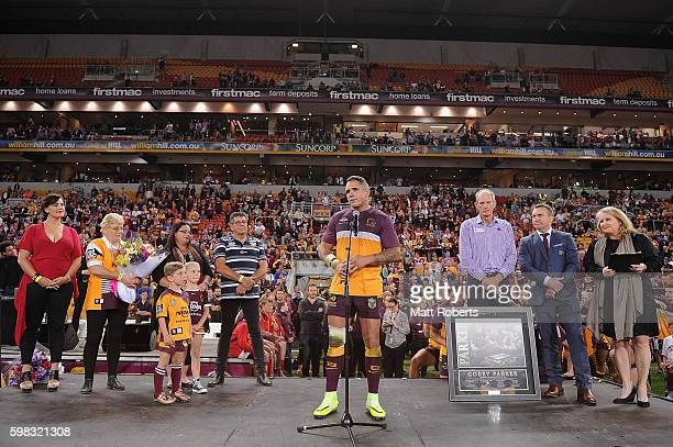 Corey Parker of the Broncos speaks on stage after the round 26 NRL match between the Brisbane Broncos and the Sydney Roosters at Suncorp Stadium on...
