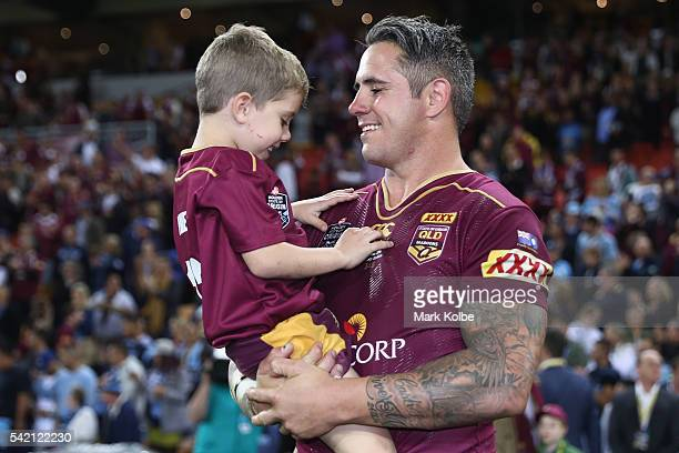Corey Parker of the Maroons celebrates victory with his son during game two of the State Of Origin series between the Queensland Maroons and the New...