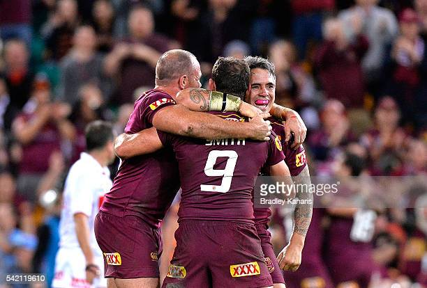Corey Parker of the Maroons celebrates victory with team mates Cameron Smith and Matthew Scott after game two of the State Of Origin series between...