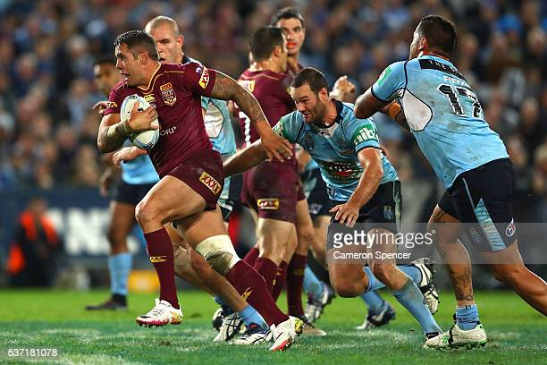 Corey Parker of the Maroons is tackled during game one of the State Of Origin series between the New South Wales Blues and the Queensland Maroons at...