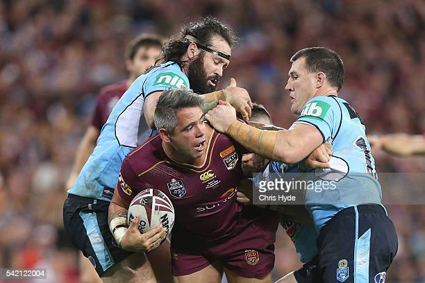 Corey Parker of the Maroons is tackled during game two of the State Of Origin series between the Queensland Maroons and the New South Wales Blues at...