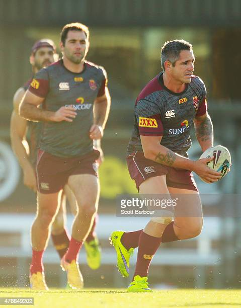 Corey Parker runs with the ball during a Queensland Maroons State of Origin team training session at Punt Road Oval on June 11 2015 in Melbourne...