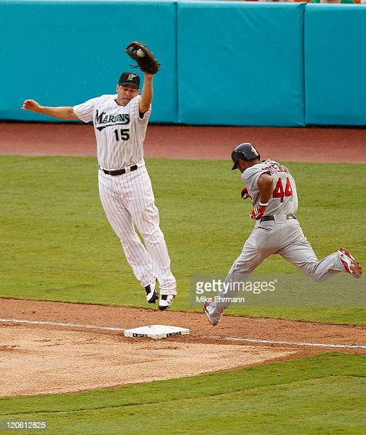 Corey Patterson of the St Louis Cardinals beats the throw as Gaby Sanchez of the Florida Marlins is pulled off the bag during a game at Sun Life...