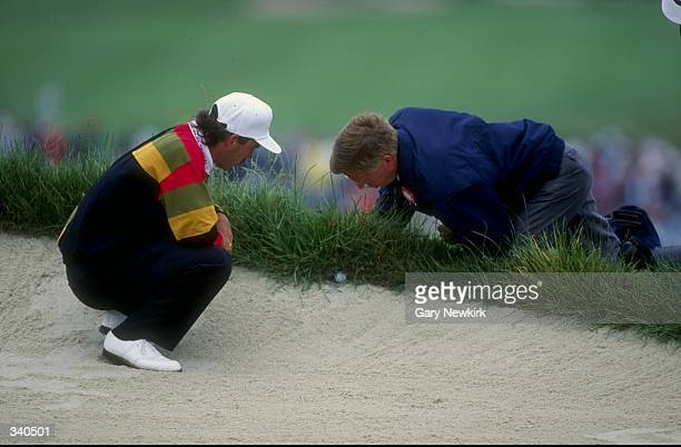 Corey Pavin inspects his bad lie just outside of the bunker during the 1992 US Open at the Pebble Beach Golf Course in Pebble Beach California...