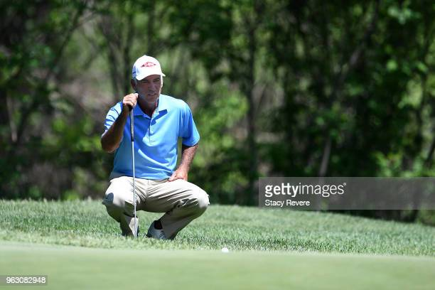 Corey Pavin lines up a putt on the first hole during the final round of the Senior PGA Championship presented by KitchenAid at the Golf Club at...