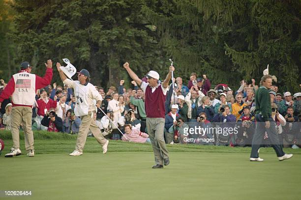 Corey Pavin of the United States celebrates victory on the 18th hole over Bernhard Langer and Nick Faldo during the 31st Ryder Cup Matches on 23...