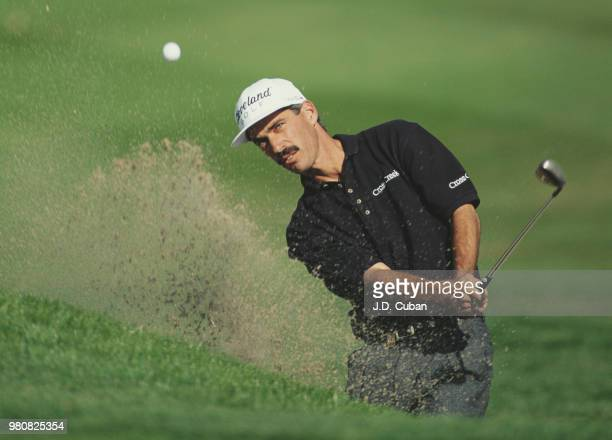 Corey Pavin of the United States keeps his eye on the ball as he hits out of the bunker during the Mercedes Championships golf tournament on 5...