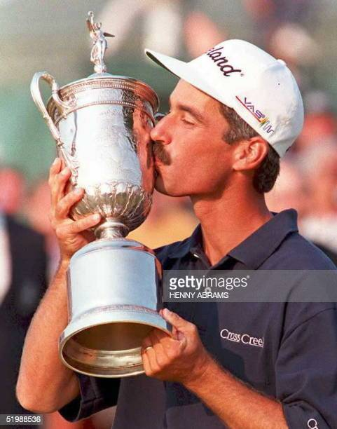 Corey Pavin of the US kisses the US Open trophy 18 June after winning the tournament at Shinnecock Hills Country Club in Southampton Pavin won the US...