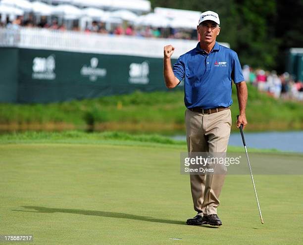 Corey Pavin reacts to sinking his birdie putt on the 18th hole during the final round of the 3M Championship at TPC Twin Cities on August 4 2013 in...