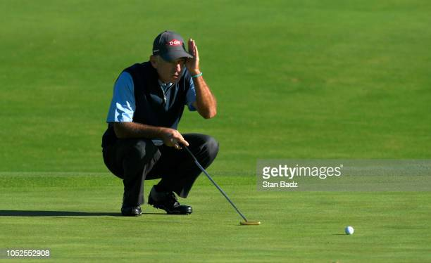 Corey Pavin studies his putt on the first hole during the first round of the PGA TOUR Champions Dominion Energy Charity Classic at The Country Club...