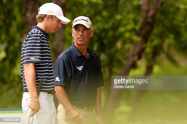 Corey Pavin talks with Jordan Spieth on the first tee prior to the fourth round of the HP Byron Nelson Championship at TPC Four Seasons Resort Las...
