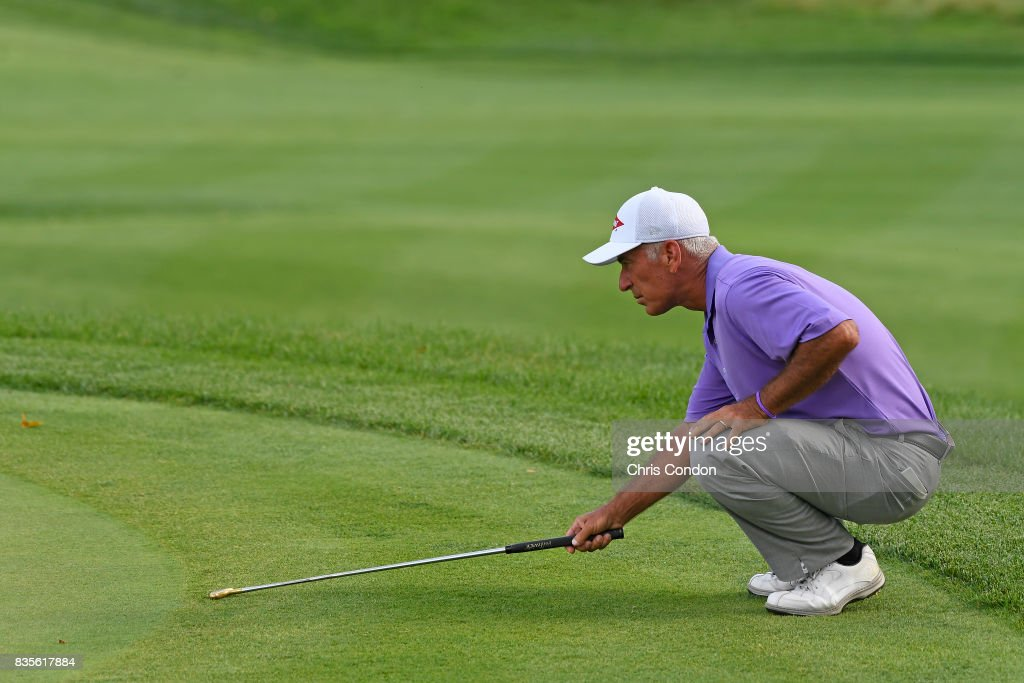 Corey Pavin tlines up a putt on the 16th green during the second round of the PGA TOUR Champions DICK'S Sporting Goods Open at En-Joie Golf Course on August 19, 2017 in Endicott, New York.