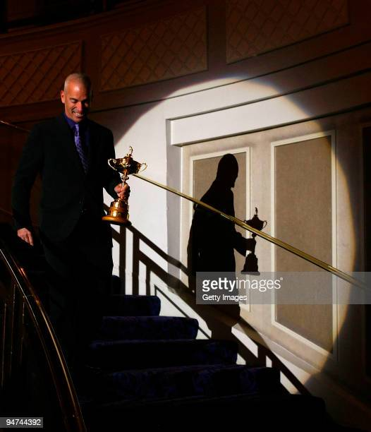 Corey Pavin walks down the stairs with the trophy during the PGA Annual Lunch at The Grosvenor Hotel on December 18 2009 in London England
