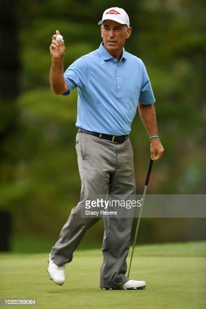 Corey Pavin waves to the crowd following a birdie on the first green during the first round of the Ally Challenge presented by McLaren at Warwick...