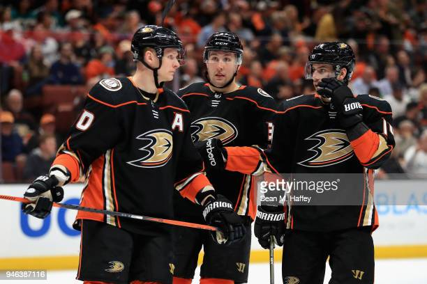 Corey Perry Adam Henrique and Nick Ritchie of the Anaheim Ducks talk during the second period in Game Two of the Western Conference First Round...