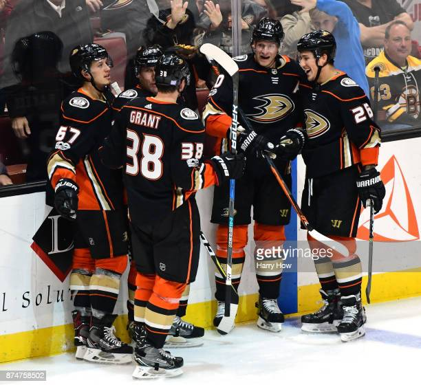 Corey Perry and Brandon Montour of the Anaheim Ducks react to the goal of Derek Grant with Rickard Rakell and Francois Beauchemin to take a 41 lead...