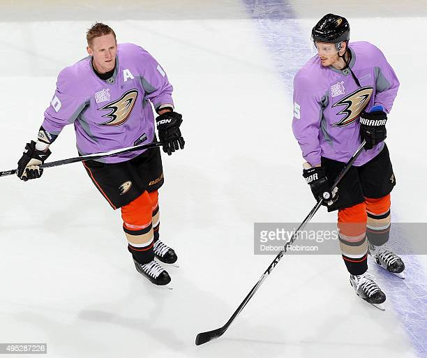 15e542827b1 Corey Perry and Korbinian Holzer of the Anaheim Ducks wear their Hockey  Fights Cancer sweaters before