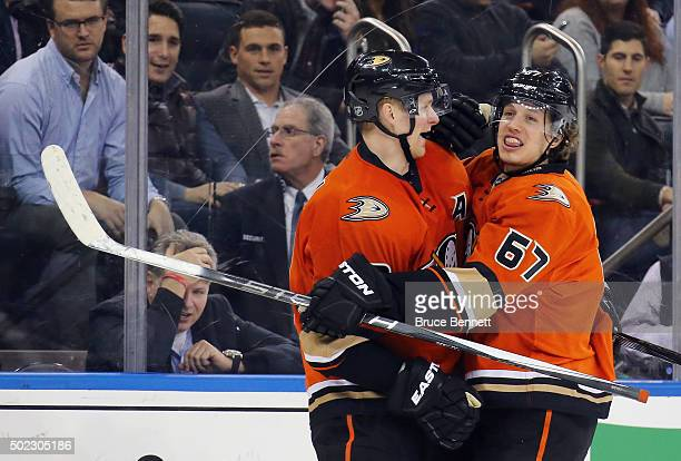 Corey Perry and Rickard Rakell of the Anaheim Ducks celebrate Rakell's goal during the third period against the New York Rangers at Madison Square...