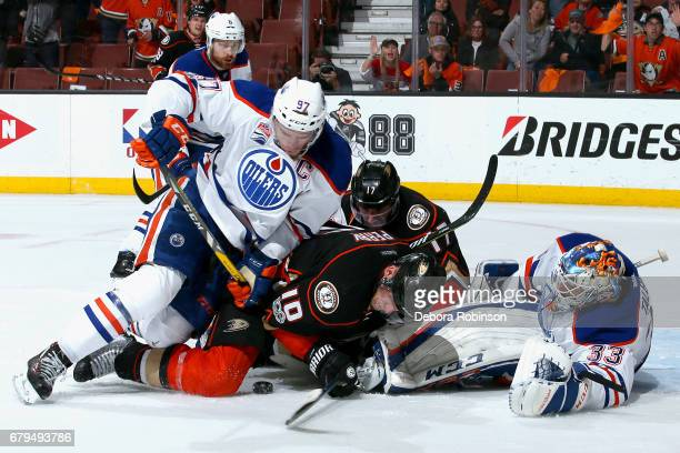 Corey Perry and Ryan Kesler of the Anaheim Ducks battle for the puck against Connor McDavid and Cam Talbot of the Edmonton Oilers in Game Five of the...
