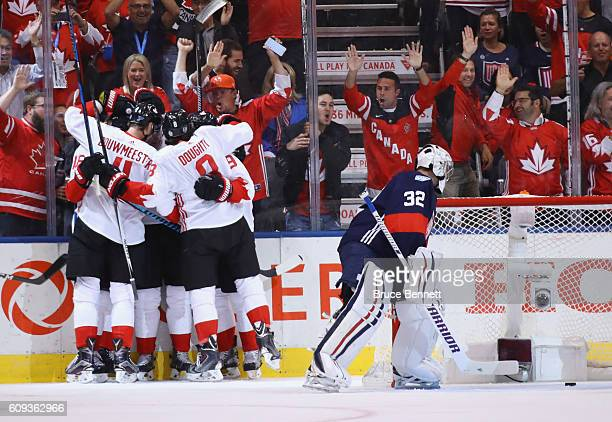 Corey Perry and Team Canada celebrate his first period goal against Jonathan Quick of Team USA during the World Cup of Hockey tournament at the Air...