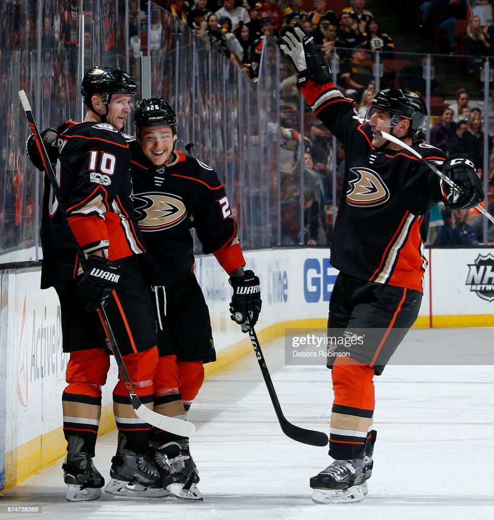 Corey Perry #10, Brandon Montour #26, and Francois Beauchemin #23 of the Anaheim Ducks celebrate a goal in the third period of the game against the Boston Bruins on November 15, 2017 at Honda Center in Anaheim, California.