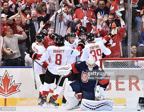 Corey Perry celebrates with Jay Bouwmeester Drew Doughty Jonathan Toews and Logan Couture of Team Canada after scoring a first period goal on Team...