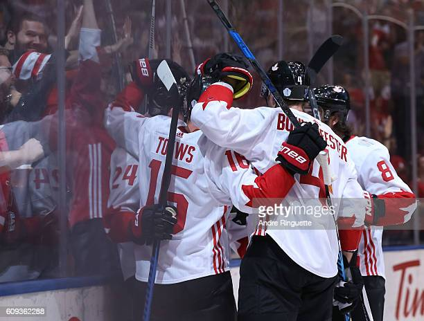 Corey Perry celebrates with Jonathan Toews Jay Bouwmeester and Drew Doughty of Team Canada after scoring a first period goal on Team USA during the...