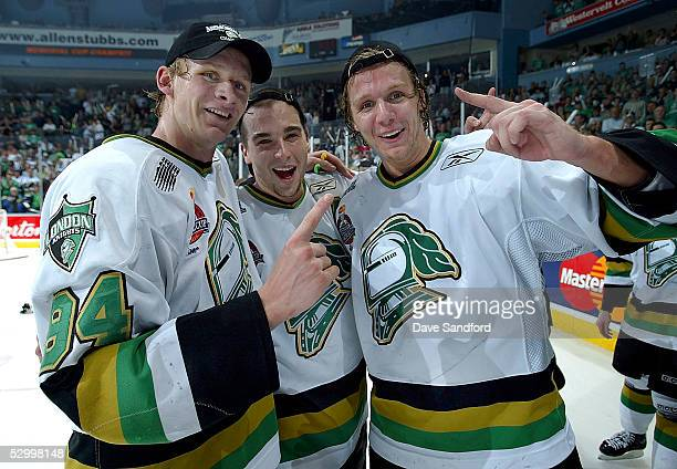 Corey Perry, Dylan Hunter and Marc Methot of the London Knights celebrate their 4-0 victory over the Rimouski Oceanic in the Memorial Cup Tournament...