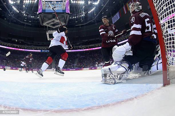 Corey Perry of Canada celebrates a thirdperiod goal by teammate Shea Weber against Kristers Gudlevskis of Latvia during the Men's Ice Hockey...