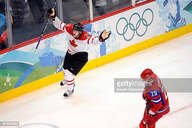 Corey Perry of Canada celebrates after a goal as Sergey Fedorov of Russia during the ice hockey men's quarter final game between Russia and Canada on...