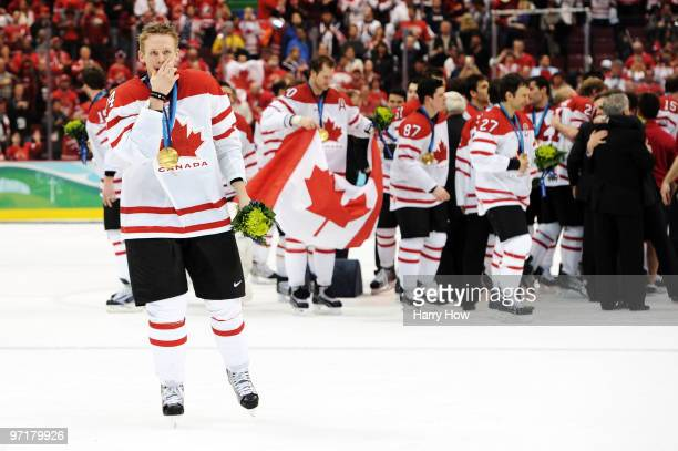 Corey Perry of Canada celebrates after receiving the gold medal won during the ice hockey men's gold medal game between USA and Canada on day 17 of...