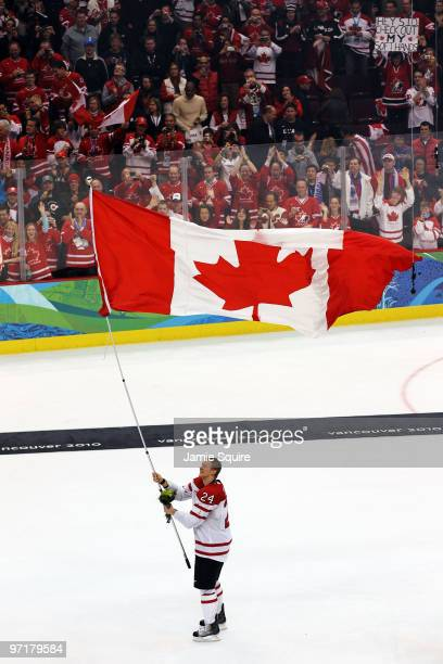Corey Perry of Canada celebrates with the flag after winning the gold medal in the ice hockey men's gold medal game between USA and Canada on day 17...