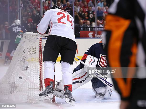 Corey Perry of Team Canada gets the puck past Jonathan Quick of Team USA to score a first period goal during the World Cup of Hockey 2016 at Air...