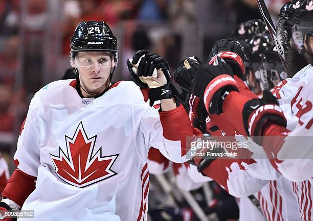 Corey Perry of Team Canada high fives the bench after scoring a first period goal on Team USA during the World Cup of Hockey 2016 at Air Canada...