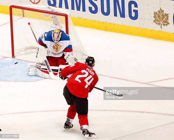 Corey Perry of Team Canada takes a shot on Sergei Bobrovsky of Team Russia during the World Cup of Hockey game at the semifinal game during the World...