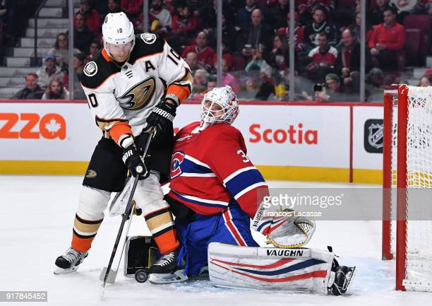 Corey Perry of the Anaheim Ducks attempts to deflect the puck against Antti Niemi of the Montreal Canadiens in the NHL game at the Bell Centre on...