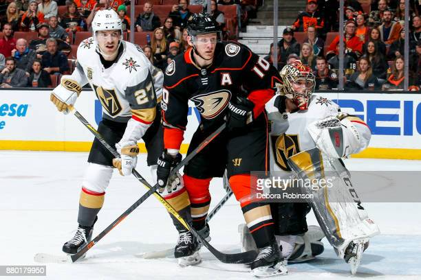 Corey Perry of the Anaheim Ducks battles for position with Shea Theodore and goalie Maxime Lagace of the Vegas Golden Knights during the third period...