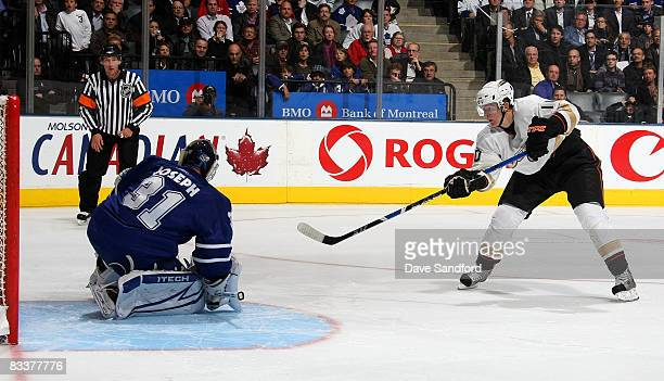 Corey Perry of the Anaheim Ducks beats Curtis Joseph of the Toronto Maple Leafs on this shot for the winning goal in the shootout during their NHL...