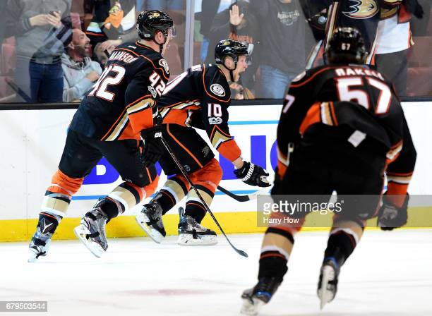 Corey Perry of the Anaheim Ducks celebrates his goal for a 43 win over the Edmonton Oilers with Josh Manson and Rickard Rakell during the second...