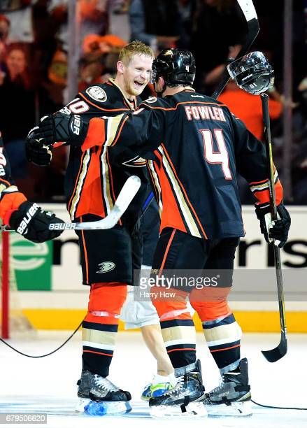 Corey Perry of the Anaheim Ducks celebrates his goal for a 43 win over the Edmonton Oilers with Cam Fowler during the second overtime in Game Five of...