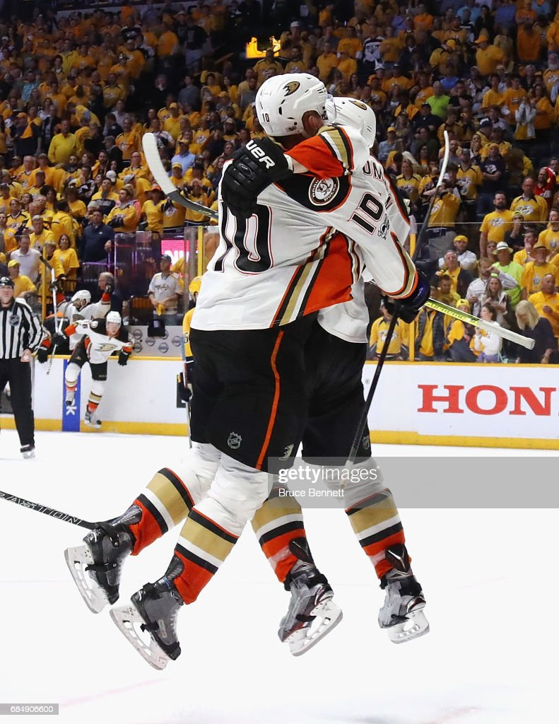 Corey Perry #10 of the Anaheim Ducks celebrates with Nate Thompson #44 after scoring a goal during the overtime period to defeat the Nashville Predators 3-2 in Game Four of the Western Conference Final during the 2017 Stanley Cup Playoffs at Bridgestone Arena on May 18, 2017 in Nashville, Tennessee.