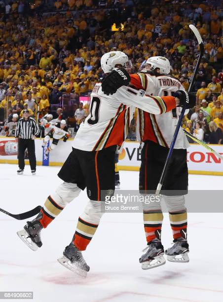 Corey Perry of the Anaheim Ducks celebrates with Nate Thompson after scoring a goal during the overtime period to defeat the Nashville Predators 32...