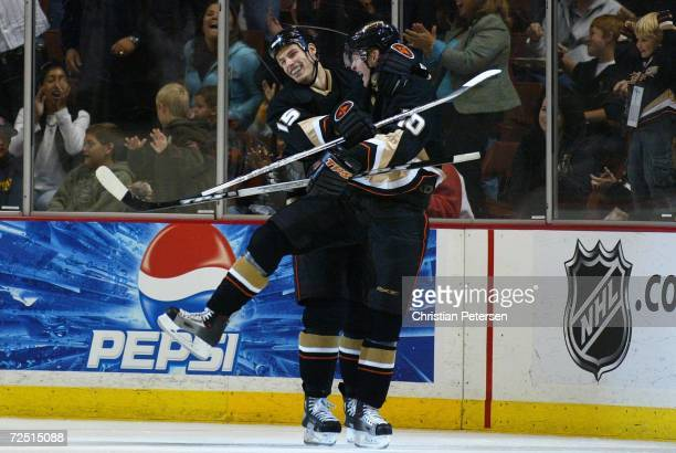 Corey Perry of the Anaheim Ducks celebrates with teammate Ryan Getzlaf after scoring against the Minnesota Wild during the second period of the NHL...