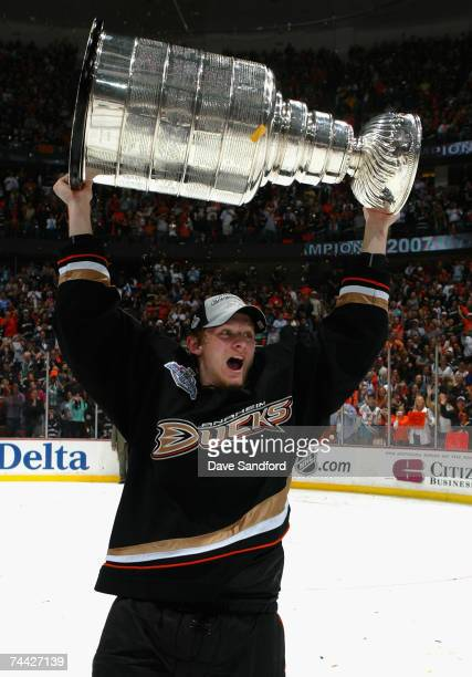 Corey Perry of the Anaheim Ducks celebrates with the Stanley Cup after defeating the Ottawa Senators in Game Five of the 2007 Stanley Cup finals on...