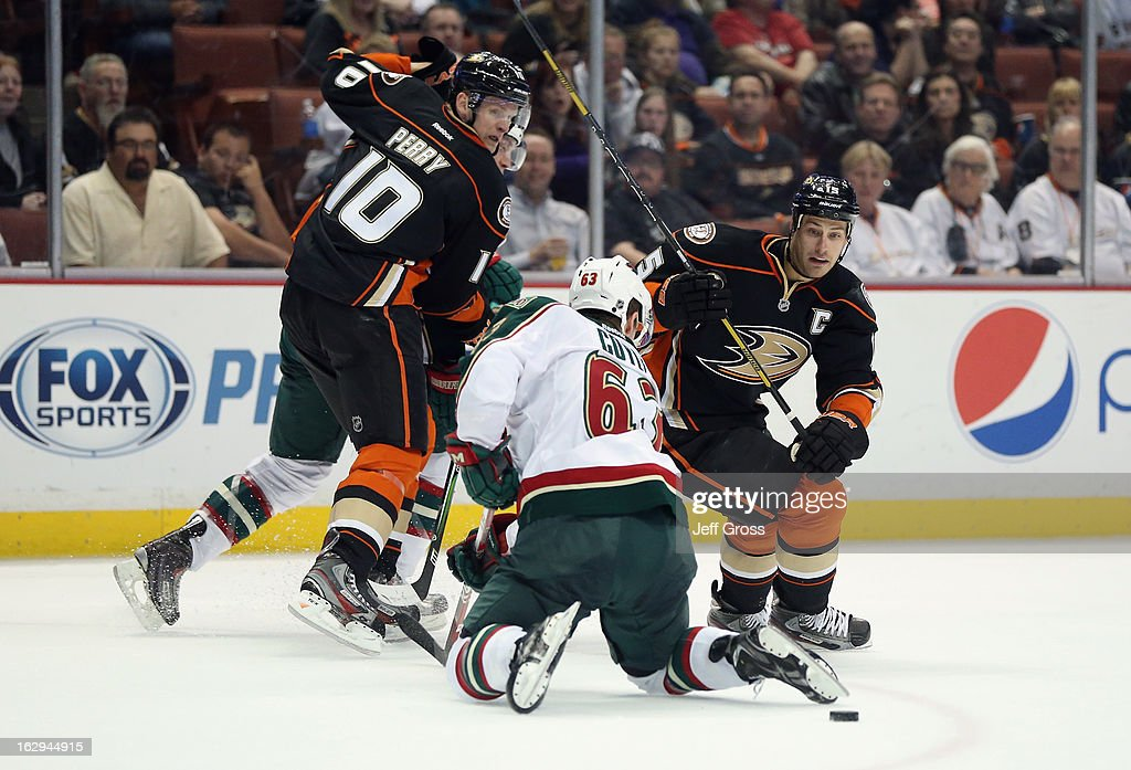 Corey Perry #10 of the Anaheim Ducks Charlie Coyle #63 of the Minnesota Wild and Ryan Getzlaf #15 of the Anaheim Ducks fight for the puck in the second period at Honda Center on March 1, 2013 in Anaheim, California. The Ducks defeated the Wild 3-2.